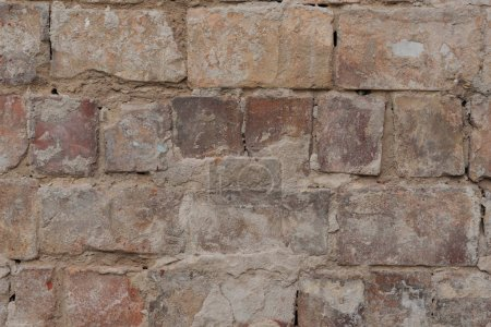 close up view of old cracked brick wall textured background