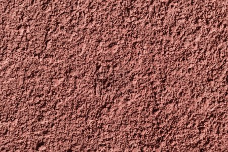 close-up view of maroon concrete wall textured background