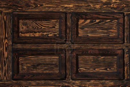 close-up view of dark brown textured wooden background