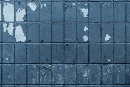 vieux mur de briques sombres avec fond patiné peinture