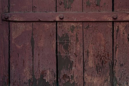 close-up view of old dark weathered wooden gate texture