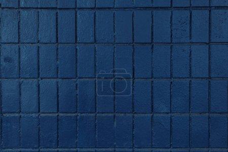 dark blue wall with old bricks, full frame background