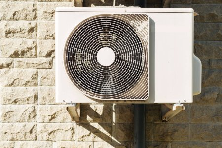 Photo for White air conditioner hanging on wall at sunny day - Royalty Free Image