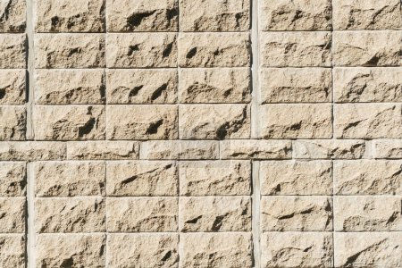 brown brick wall at sunny day, full frame background