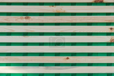 Photo for Horizontal wooden planks on green, full frame background - Royalty Free Image