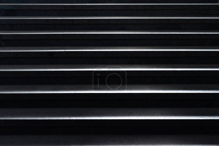 shiny horizontal metal strips on black