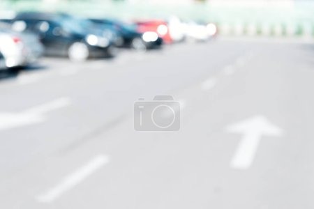 blurred background with cars parked on parking lot