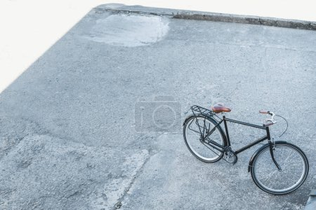 Photo for High angle view of one bicycle on street in city - Royalty Free Image