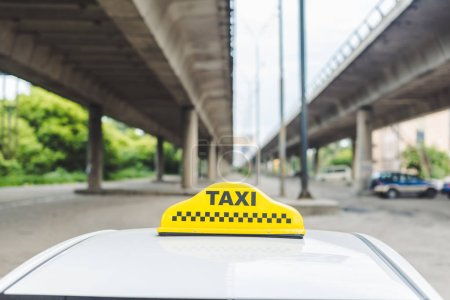 close-up view of yellow taxi sign on top of cab