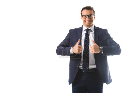 smiling businessman in eyeglasses showing thumbs up gesture isolated on white background