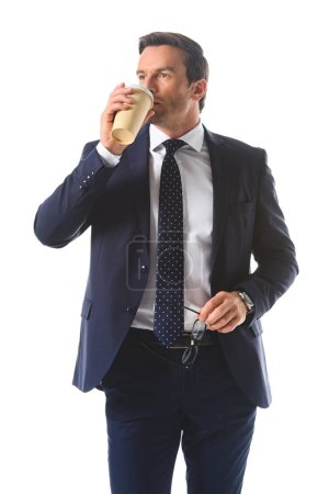 businessman holding eyeglasses and drinking coffee isolated on white background