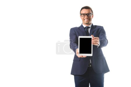 smiling businessman in eyeglasses holding digital tablet with blank screen isolated on white background