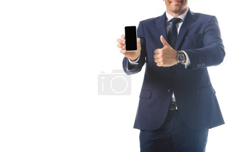 cropped image of businessman holding smartphone with blank screen and doing thumb up gesture isolated on white background