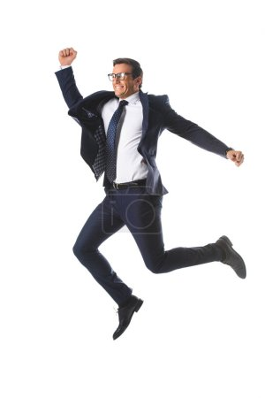 Photo for Excited businessman in eyeglasses jumping and gesturing by hands isolated on white background - Royalty Free Image