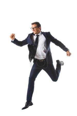 excited businessman in eyeglasses jumping and gesturing by hands isolated on white background