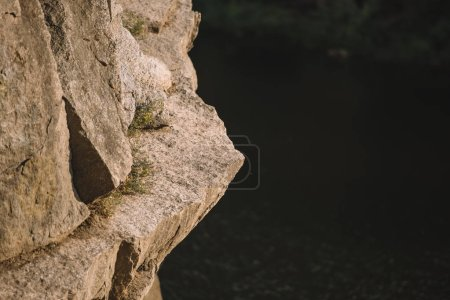 selective focus of rocky cliff over river
