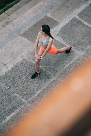 overhead view of athletic woman doing lunges