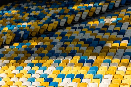 empty colorful seats on tribunes of stadium