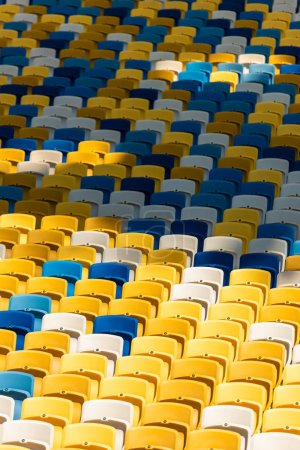 full frame shot of empty colorful seats on tribunes of stadium
