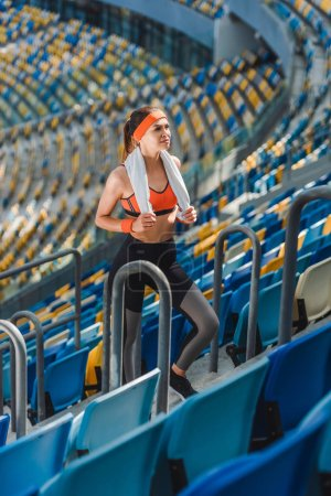 high angle view of attractive young woman with towel at sports stadium