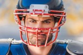 close-up shot of angry young american football player
