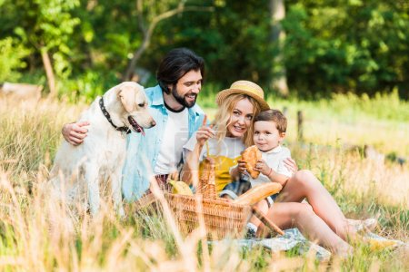 mother pointing on something to son at picnic