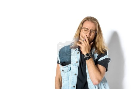 handsome young man in stylish eyeglasses smoking weed on white