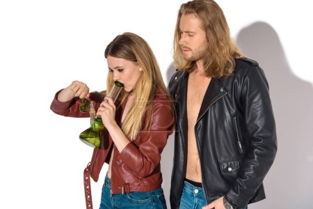 young addicted couple with water pipe smoking marijuana on white