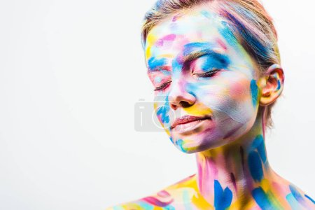 attractive girl with colorful bright body art standing with closed eyes isolated on white