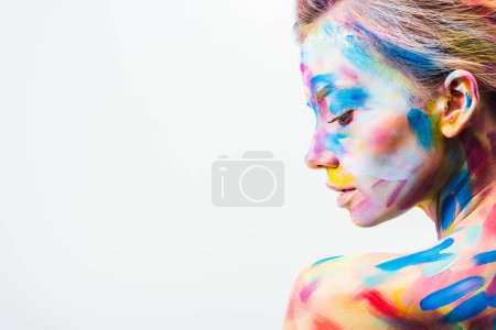 side view of attractive girl with colorful bright body art isolated on white