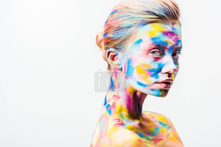 attractive girl with colorful bright body art looking at camera isolated on white