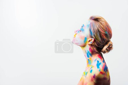 Photo for Side view of attractive girl with colorful bright body art and closed eyes isolated on white - Royalty Free Image