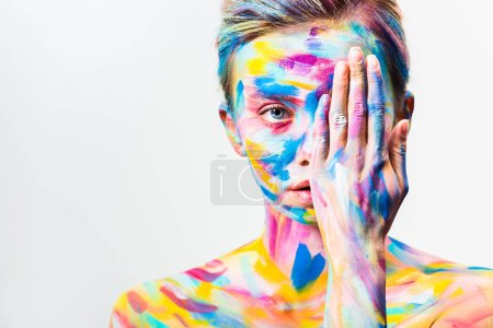 attractive girl with colorful bright body art covering eye isolated on white