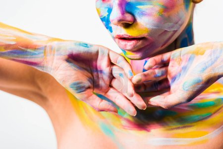 cropped image of woman with bright colorful bright body art isolated on white