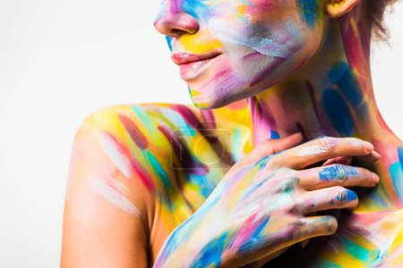 cropped image of girl with colorful bright body art touching neck isolated on white