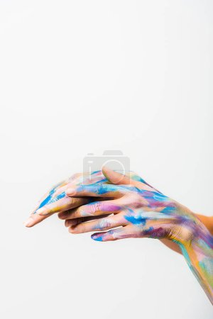 cropped image of girl with colorful bright body art touching hands isolated on white