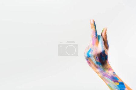 cropped image of girl with colorful bright body art showing middle finger isolated on white