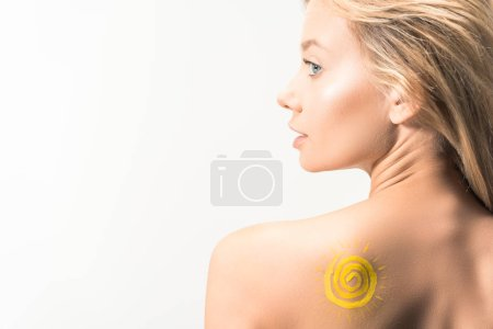 beautiful girl with painted yellow sun on shoulder looking away isolated on white