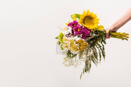 cropped image of woman holding bouquet of flowers isolated on white