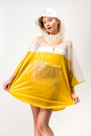 beautiful woman posing in yellow raincoat isolated on white