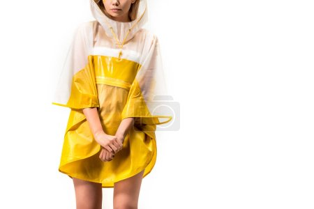 cropped image of woman standing in yellow raincoat isolated on white