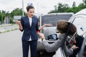 businesspeople screaming on road after car accident