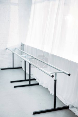 high angle view of dancing barre in empty ballet school