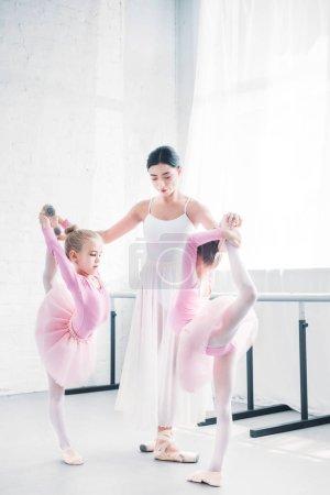 young ballet teacher training little ballerinas in ballet school