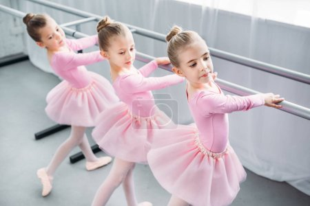 Photo for High angle view of elegant little ballerinas dancing in ballet school - Royalty Free Image