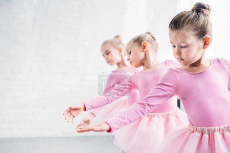 Photo for Beautiful little kids in pink clothing dancing in ballet studio - Royalty Free Image