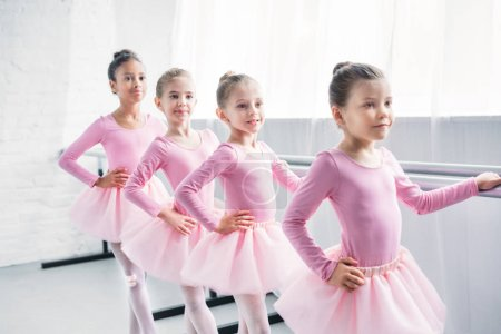 Photo for Adorable little ballerinas practicing ballet in studio - Royalty Free Image