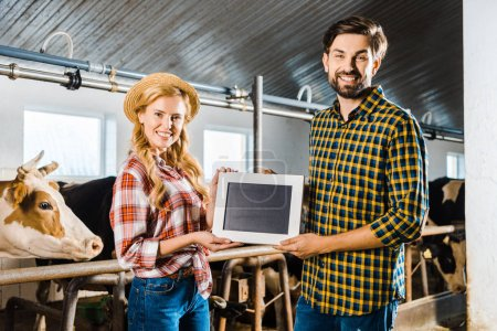 couple of farmers showing blackboard in stable