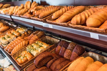 Photo for Selective focus of freshly baked various bread in pastry department of grocery store - Royalty Free Image