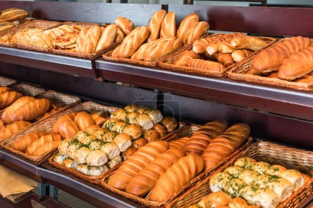Photo for Selective focus of freshly baked various bread in pastry department of hypermarket - Royalty Free Image